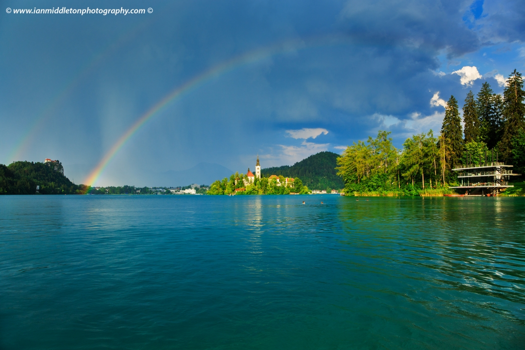 Double rainbow over Lake Bled's island church as a storm blows over, Slovenia.