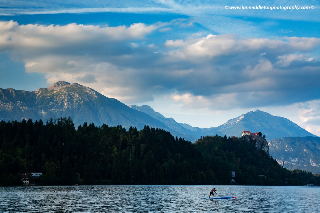 View across the beautiful Lake Bled to the hilltop castle and Mount Stol, Slovenia.