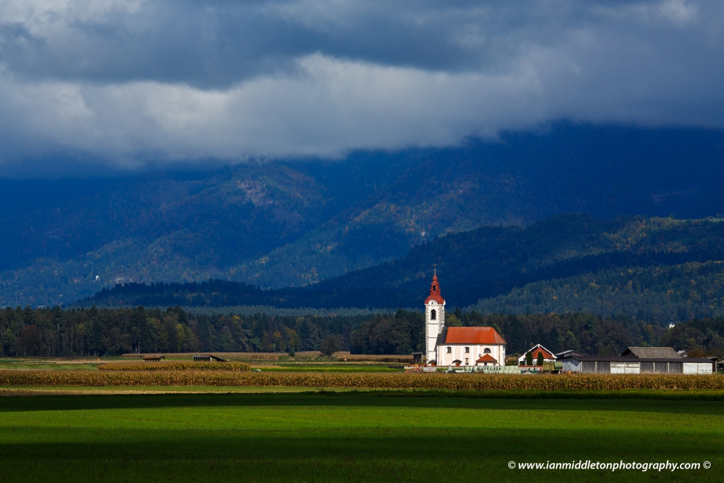 View of the the church of saint John in Sp. Brnik, Slovenia. Seen from Brnik, near the Ljubljana airport.