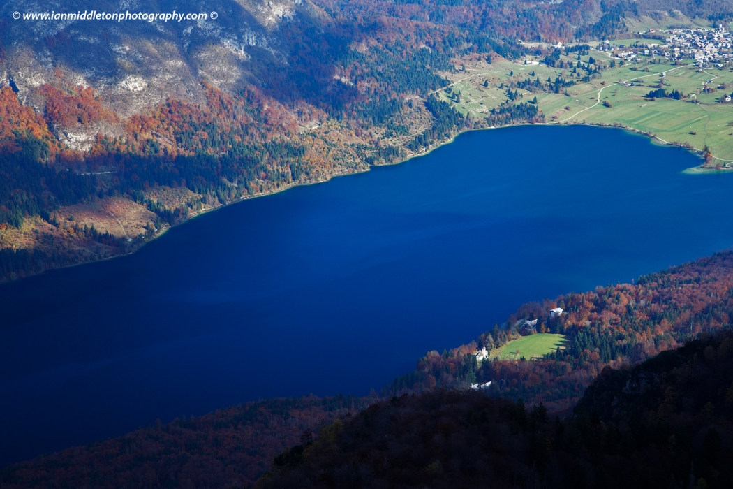 View over Bohinj Lake on an autumn day, seen from Vogel Mountain Ski Resort, Triglav National Park, Slovenia.
