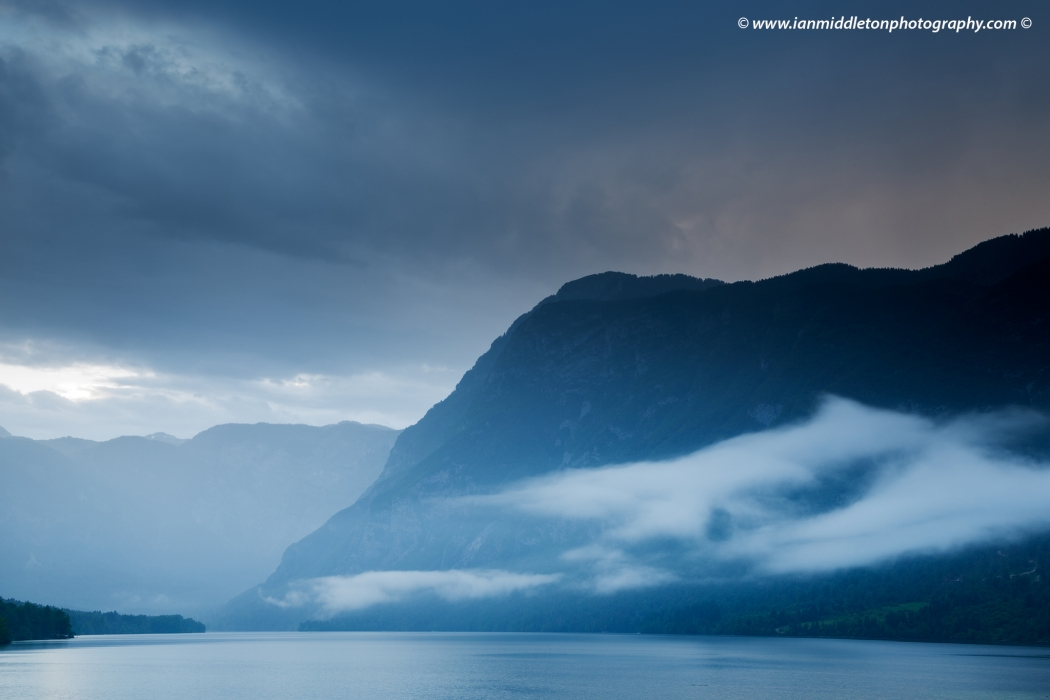 Nice moody evening light over Lake Bohinj at sunset while raining, Triglav National Park, Slovenia.